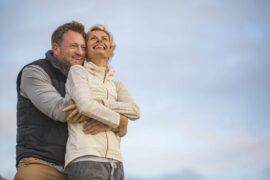 Happy older couple outside