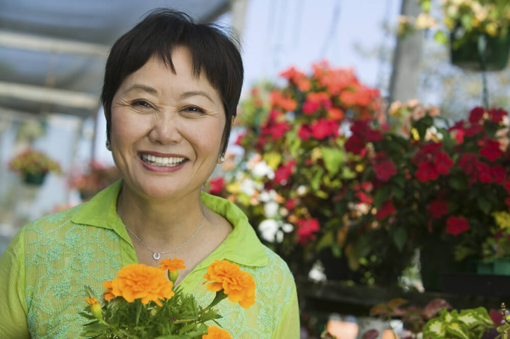 Smiling woman at a flower shop